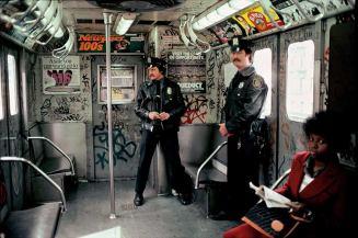 Martha-Cooper-Cops-in-the-train-1981-widewalls-allcitycanvas