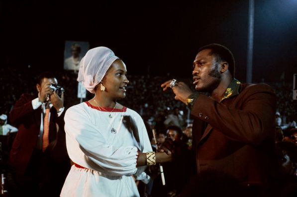 ZAIRE. Kinshasa. October 30th 1974. World Heavyweight Boxing Championship between American fighters Muhammad ALI and George FOREMAN. Joe FRAZIER who defeated ALI in a previous match talks to Belinda, ALI's wife.