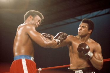 ZAIRE. Kinshasa. October 30th 1974. World Heavyweight Boxing Championship between American fighters Muhammad ALI and George FOREMAN. On the right: Muhammad ALI, throwing a punch.