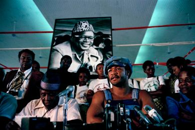 Heavyweight boxer George Foreman holds a press conference at N'sele, near Kinshasa in Zaire, Sept. 18, 1974. This was the first time he faced the press since suffering a cut over his right eye. (AP Photo)