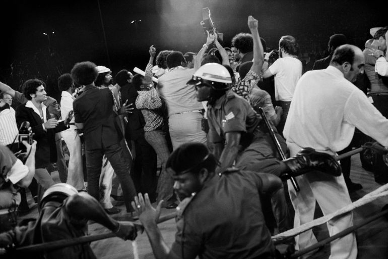 ZAIRE. Kinshasa. ALI-FOREMAN Boxing Fight. A crowd invades the ring after Muhammad ALI (center) knocked out George FOREMAN. 1974.
